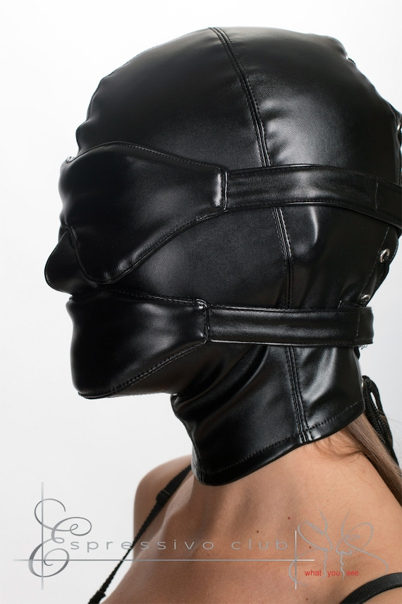 Woman in leather bondage hood