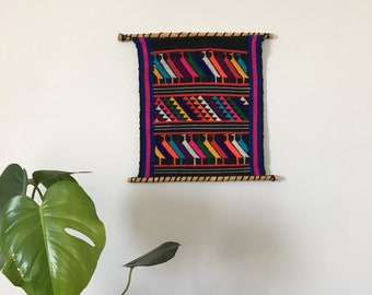small colorful peruvian wall hanging