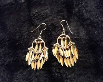 Vintage Gold Tone Metal Pierced Dangle Earrings With Hanging Leaf Shaped Tassels