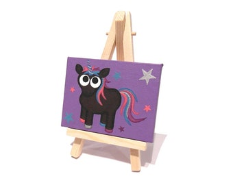 Black Unicorn Art - small acrylic painting of a cute dark unicorn on a purple mini canvas with stars. Mythical creature artwork with easel