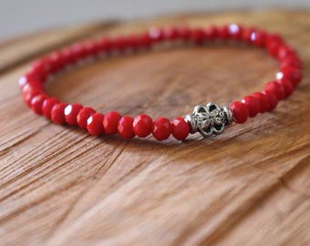 Red protection bracelet by Paz Gabriel