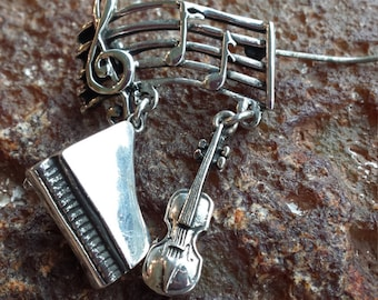 Sterling silver vintage musical brooch