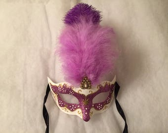 Purple Carnival Venetian mask and gold ostrich feather