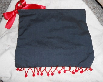 Black pouch with red bead fringe