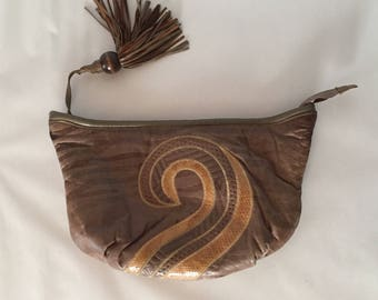 large leather taupe brown clutch | 1980s scroll geometric embroidered clutch | fringe pull leather purse