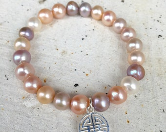 Mauve pink freshwater pearl charm bracelet/ simple pink pearl bracelet/ everyday jewelry/ silver charm stacking bracelet/ good luck charm