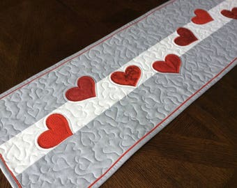 Trail of Hearts Quilted Valentine Table Runner - red hearts on gray and white background