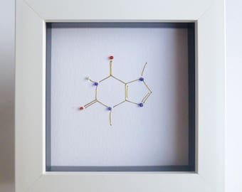 Chocolate - Theobromine Molecule - gold thread, glass beads, hand embroidered on paper, box framed.