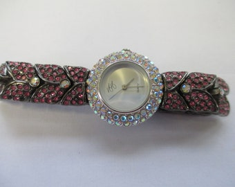 "Vintage lady's watch ""Suzanne Somers""  rhinestoned white face and pink and black band with snap closure   used watch"
