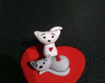 Figurine of a couple of cat lovers of cold porcelain.