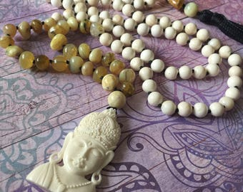 Vishnu as Buddha mala in tridacna and opal