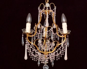 Very pretty and charming chandelier with beads