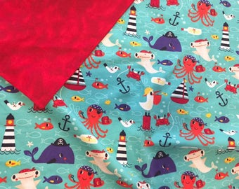 Nautical Baby Boy blanket, receiving blanket, red and teal/aqua flannel printed with anchors, boats, octopus, birds, fish and lighthouses
