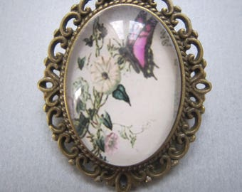 Pink butterfly and white flower brooch