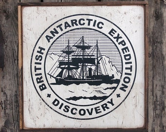 Vintage wooden sign ' Discovery Expedition Emblem ' reproduction concept.