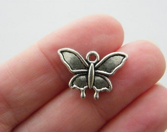 8  Butterfly charms antique silver tone A369