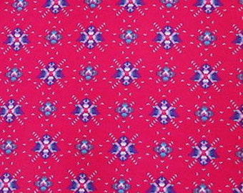 100% Rayon Red with Blue Small Triangle Print fabric by the yard