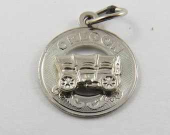 A Wagon from the State of Oregon Sterling Silver Charm or Pendant.