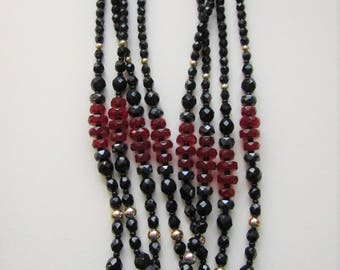Red and black glass bead necklace.