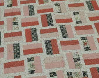 Coral, cream and black handmade lap quilt