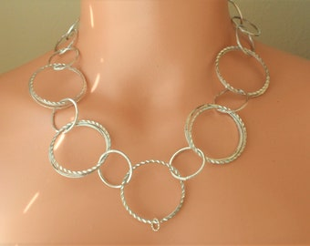 Silver Circles Necklace.Statement necklace.Interlocking  circles.Tarnish resistant necklace,3 inch extension .Matching Silver Hoop Earrings