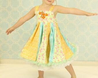 custom boutique dress made with nemo fabric size 2-6