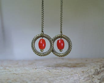 Very fine and delicate earrings formed a fine Pearl grain of rice in tomato red glass in