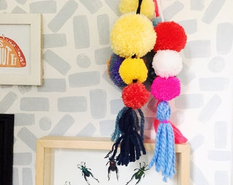 Pom pom tassle door hanger with neon pop