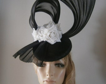 perching beret in black sinamay adorned with silk abaca bows & silken white roses