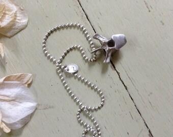 Sterling silver vertebrae