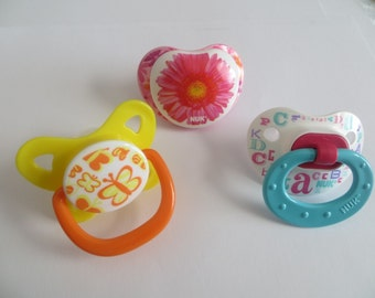 3 Reborn Magnetic or Putty Pacifiers OUR CHOICE of Girl Designs. Doll NOT included. Use Drop Down Menu to Choose Magnet or Putty