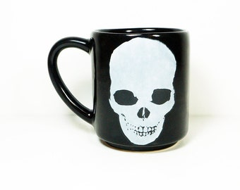 15oz coffee mug/tea mug with giant badass White Dark Skull on both sides, shown here in Blackest Black glaze. READY TO SHIP
