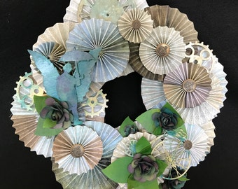 Steampunk style paper rosette wreath with roses and gears