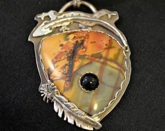 Southwestern lizard and stone on stone pendant.