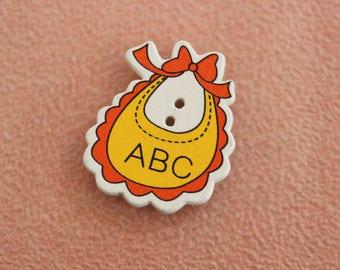 button wood orange yellow baby bib