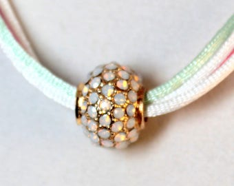 Opal Crystal Individuality Bead on Pink, Green, and White Satin Necklace