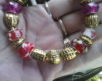 Rich Reds and gold hues, Euro style bracelet