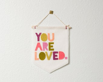 you are loved. -- MID-SIZE wall hanging / banner // nursery decor, girl nursery wall decor, coral green purple, love wall hanging banner