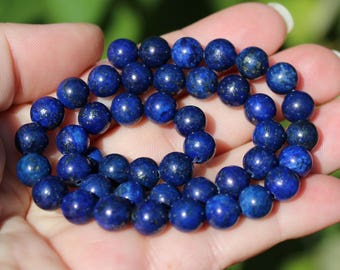 Lapis Lazuli blue 8 MM round beads. AA *.