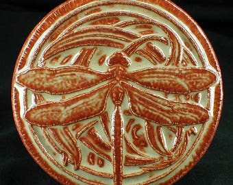 Ceramic dragonfly tile with glossy cream/iron red glaze