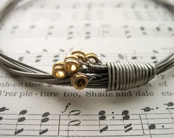Recycled Electric Guitar String Bracelet silver colored with brass ball ends attached Mens Unique Gift