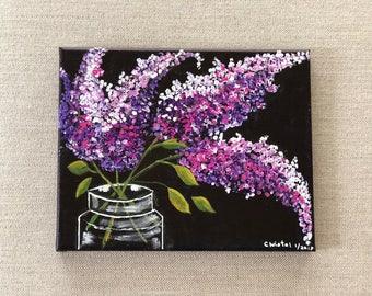 Lilacs in a glass jar
