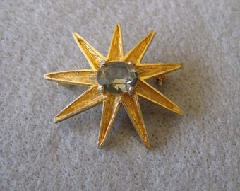 Vintage gold toned Starburst with Rhinestone Center Pin Brooch