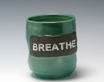 Handmade ceramic yunomi teabowl 12 ounces in emerald green with the word Breathe/Ceramics and Pottery
