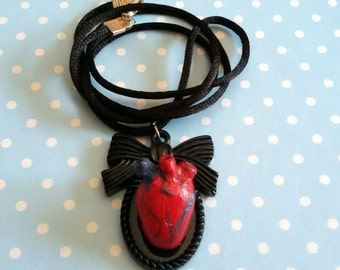 Rockabilly zombie horror-style necklace with anatomical heart