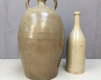 Tall vintage French stoneware vessel bottle with handles. Gorgeous glossy cool grey beige stone