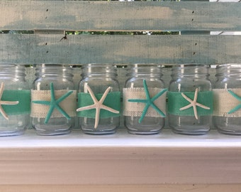 6 glass jars with hand painted sea stars.