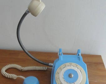 Turned item: light blue vintage telephone