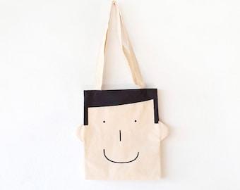 Canvas bag with smiley boy face printed in black. Fun tote bag with ears!, best canvas tote bag for gift. Reusable shopper bag eco-friendly