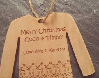 Personalised wooden Christmas decoration, in the style of a jumper.